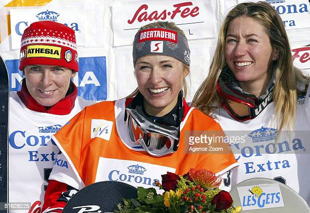 Doresia Krings of Austria celebrates victory in the FIS Womens World Cup Snowboardcross Event with Carmen Ranigler of Italy in second place and...