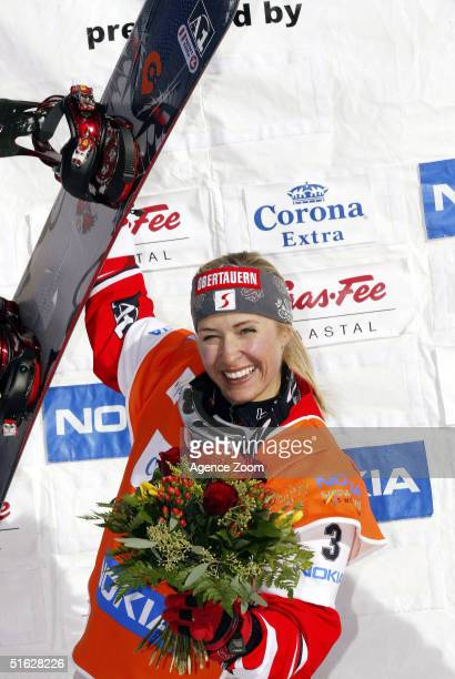 Doresia Krings of Austria celebrates victory in the FIS Womens World Cup Snowboardcross Event on October 30 2004 in SaasFee Switzerland