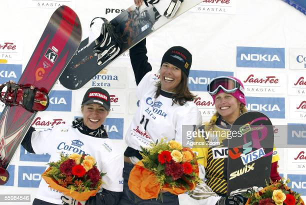 Doresia Krings of Austria second place Marie Laissus of France first place and Lindsey Jacobellis of the USA third place celebrate on the podium...