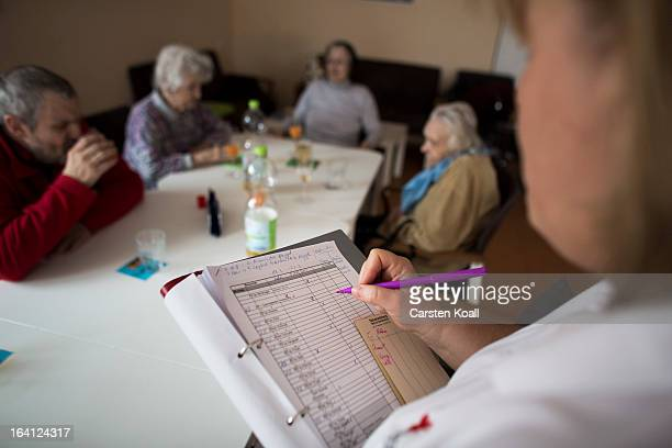 Doret Kohl creates a directory in the geriatric day care facility of the German Red Cross at Villa Albrecht on March 18 2013 in Berlin Germany A...