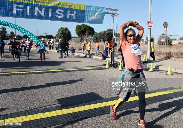 Doria Ragland crosses the finish line at the 21st Annual Alive And Running 5k For Suicide Prevention on September 29 2019 in Los Angeles California