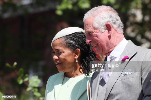 Doria Ragland Megan Markle's mother and Prince Charles Prince of Wales leave St George's Chapel at Windsor Castle following the wedding of Prince...
