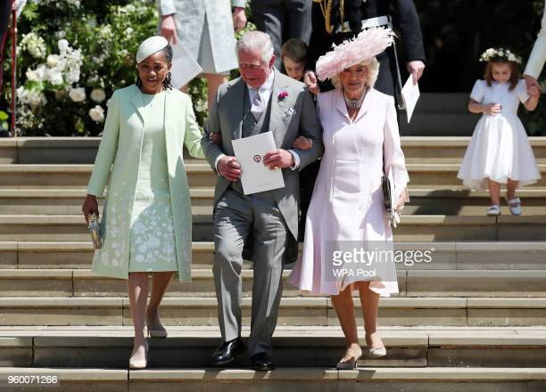 Doria Ragland mother of the bride Prince Charles Prince of Wales and Camilla Duchess of Cornwall walk down the steps at Windsor Castle after the...
