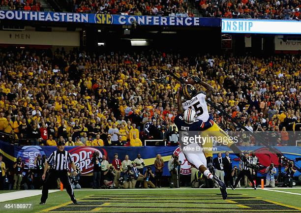 Dorial GreenBeckham of the Missouri Tigers scores a touchdown in the first quarter against the Jonathon Mincy of the Auburn Tigers during the SEC...