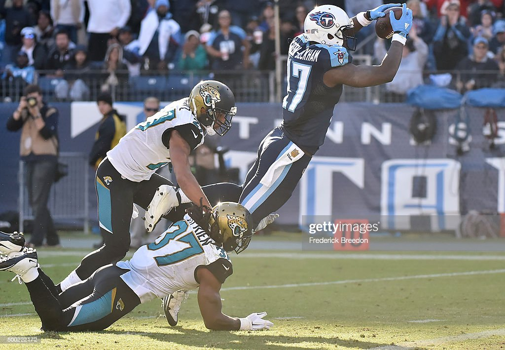 Dorial Green-Beckham #17 of the Tennessee Titans dives to the end zone against the Jacksonville Jaguars during the game at Nissan Stadium on December 6, 2015 in Nashville, Tennessee.