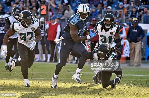Dorial GreenBeckham of the Tennessee Titans scores a touchdown against Johnathan Cyprien and Davon House of the Jacksonville Jaguars at Nissan...