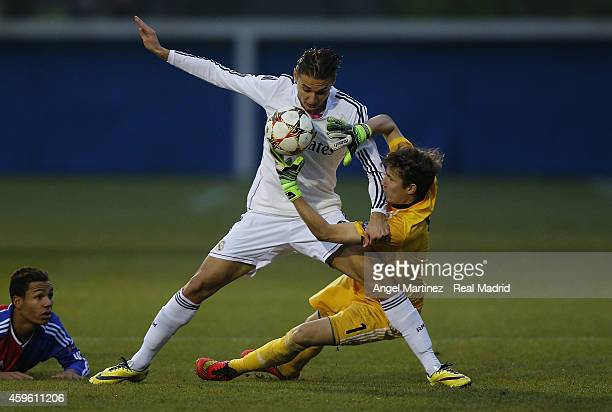 Dorian Babunski of Real Madrid competes for the ball with Andres Zimmermann of FC Basel 1893 during the UEFA Youth League match between FC Basel 1893...