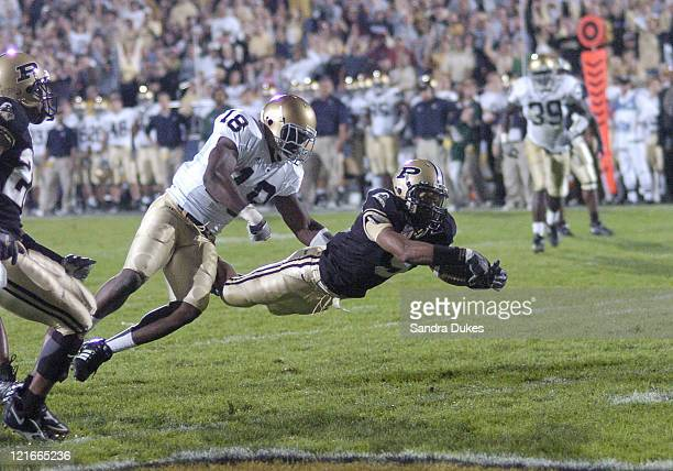 Dorian Bryant dives for a TD as Chinedum Ndukwe watches in Notre Dame's 49-28 win over Purdue in Ross Ade Stadium, West Lafayette, IN 10-1-05.