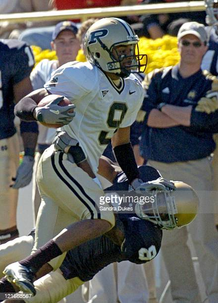 Dorian Bryant uses a straight arm on Quentin Burrell of Notre Dame after a pass reception in the first quarter of Purdue's 41-16 win over Notre Dame...