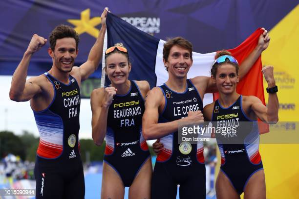 Dorian Coninx Leonie Periault Pierre Le Corre and Cassandre Beaugrand of France celebrates after winning the Mixed Team Relay Triathlon on Day Ten of...