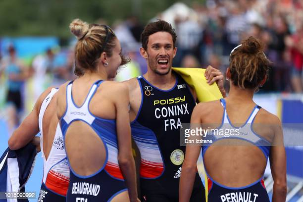 Dorian Coninx Leonie Periault Pierre Le Corre and Cassandre Beaugrand of France celebrates at the finish line after winning the Mixed Team Relay...