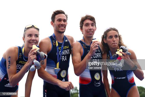 Dorian Coninx Leonie Periault Pierre Le Corre and Cassandre Beaugrand of France celebrates at the podium after winning the Mixed Team Relay Triathlon...