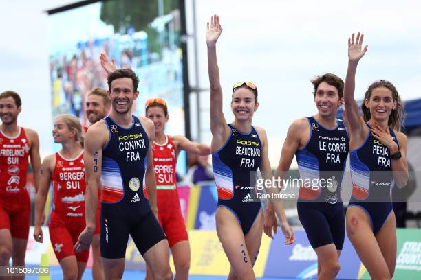 Dorian Coninx Leonie Periault Pierre Le Corre and Cassandre Beaugrand of France celebrates on their way to the podium after winning the Mixed Team...