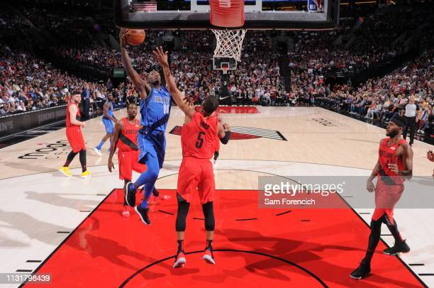 Dorian FinneySmith of the Dallas Mavericks goes to the basket against the Portland Trail Blazers on March 20 2019 at the Moda Center Arena in...