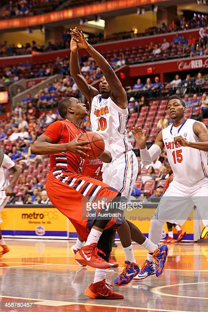 Dorian FinneySmith of the Florida Gators attempts to defend Marvelle Harris of the Fresno State Bulldogs as he drives to the basket during the...