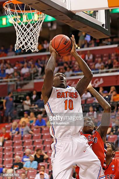 Dorian FinneySmith of the Florida Gators goes to the basket against the Fresno State Bulldogs during the MetroPCS Orange Bowl Basketball Classic on...