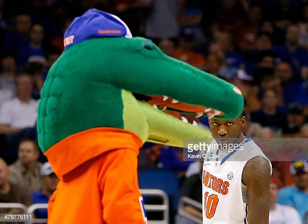 Dorian FinneySmith of the Florida Gators stands alongside the Gators mascot in the second half against the Albany Great Danes during the second round...