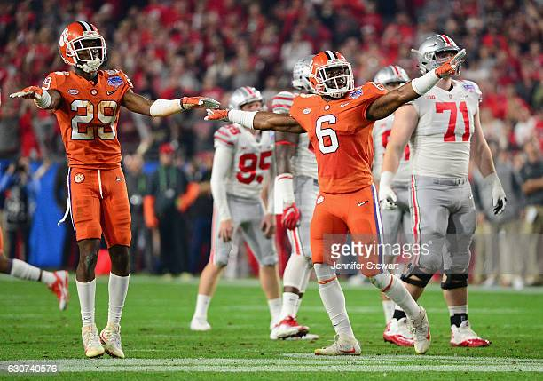 Dorian O'Daniel of the Clemson Tigers and Marcus Edmond react after a missed field goal by the Ohio State Buckeyes during the first half of the 2016...