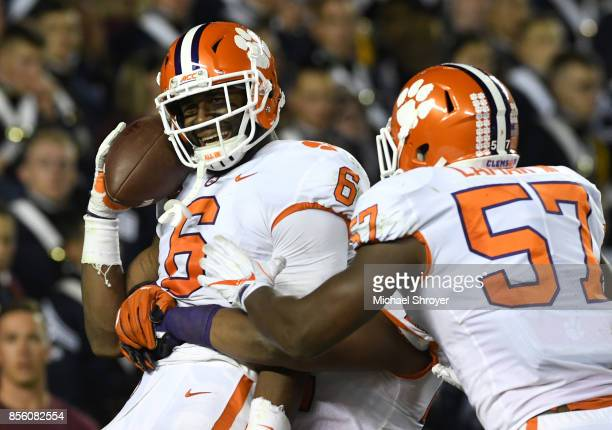 Dorian O'Daniel of the Clemson Tigers celebrates after returning an interception for a touchdown during the fourth quarter against the Virginia Tech...