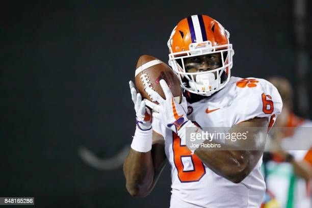 Dorian O'Daniel of the Clemson Tigers holds the ball up to his ear after returning an interception 44 yards for a touchdown in the third quarter of a...