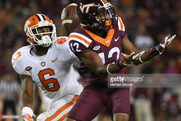 Dorian O'Daniel of the Clemson Tigers intercepts a pass intended for Henri Murphy of the Virginia Tech Hokies during the fourth quarter of their game...