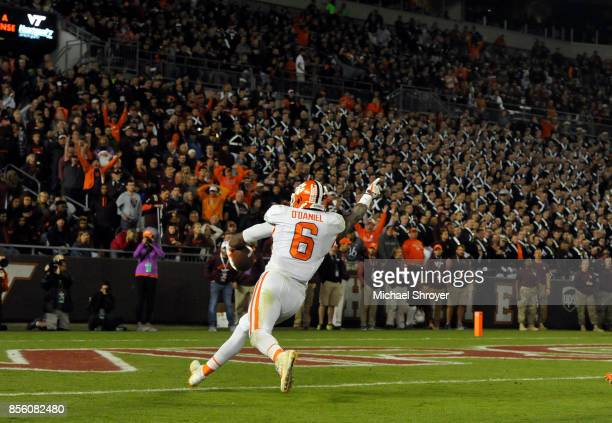Dorian O'Daniel of the Clemson Tigers returns an interception for a touchdown during the fourth quarter against the Virginia Tech Hokies at Lane...
