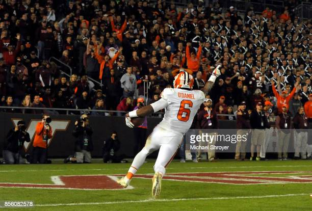 Dorian O'Daniel of the Clemson Tigers returns an interception for a touchdown during the fourth quarter against the Virginia Tech Hokies at Lane...