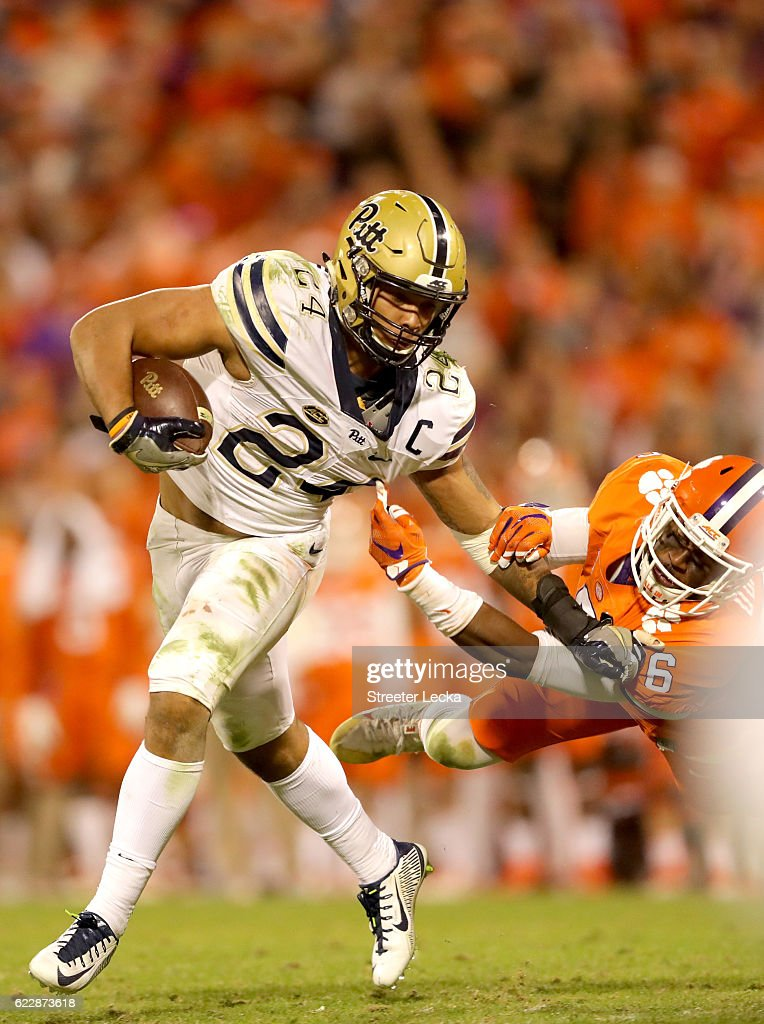 Dorian O'Daniel #6 of the Clemson Tigers tries to tackle James Conner #24 of the Pittsburgh Panthers during their game at Memorial Stadium on November 12, 2016 in Clemson, South Carolina.