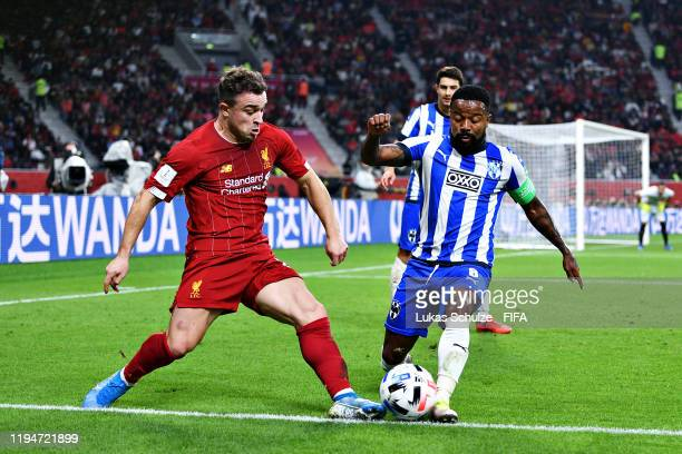 Dorian Pabon of CF Monterrey is challenged by Xherdan Shaqiri of Liverpool during the FIFA Club World Cup semifinal match between Monterrey and...