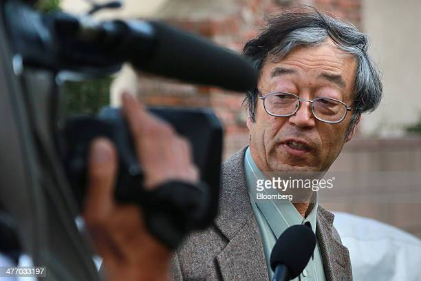 Dorian S Nakamoto identified by Newsweek magazine as the founder of Bitcoin speaks to members of the media as he arrives home in Temple City...