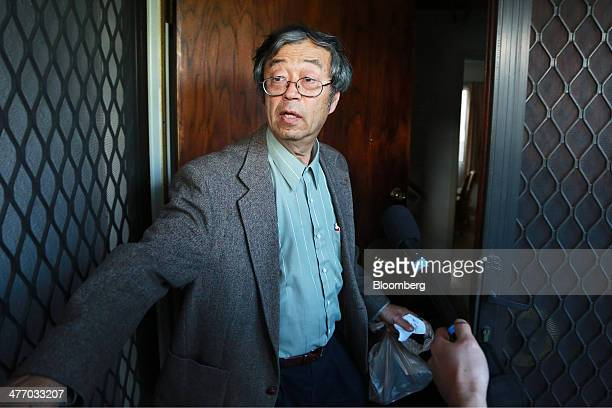 Dorian S Nakamoto identified by Newsweek magazine as the founder of Bitcoin stands surrounded by members of the media as he arrives home in Temple...