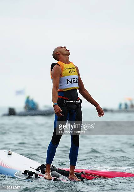 Dorian Van Rijsselberge of Netherlands celebrates after winning gold in the Men's RSX Sailing on Day 11 of the London 2012 Olympic Games at the...