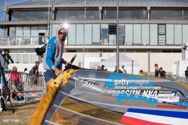 Dorian van Rijsselberghe from the Dutch Sailing Team rigs his RSX during day eight of the 2014 ISAF Sailing World Championships on September 19 2014...