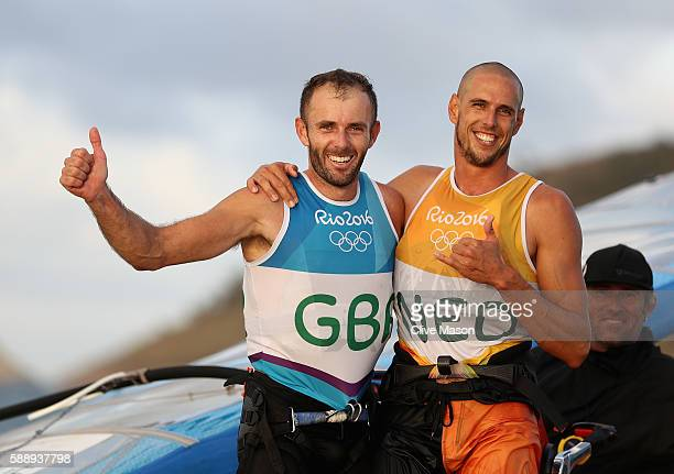 Dorian van Rijsselberghe of Netherlands celebrates securing a gold medal and Nick Dempsey of Great Britain celebrates securing silver on Day 7 of the...