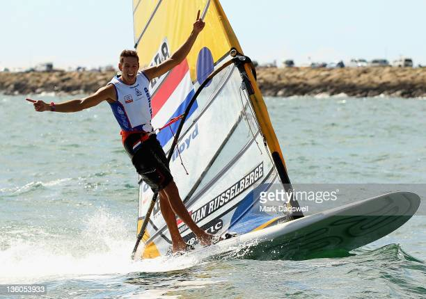 Dorian van Rijsselberghe of the Netherlands celebrates winning the RS:X Men's Windsurfer Medal race on the Centre Course during day 16 of the ISAF...