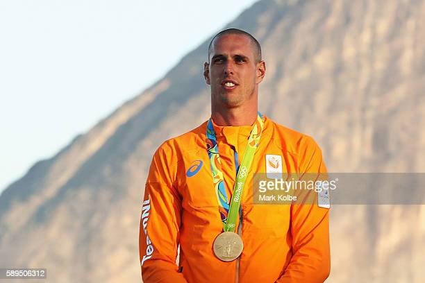 Dorian van Rijsselberghe of the Netherlands celebrates winning the gold medal in the Men's RSX class on Day 9 of the Rio 2016 Olympic Games at the...