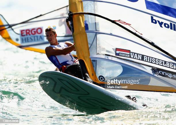Dorian van Rijsselberghe of the Netherlands competes in the RS:X Men's Windsurfer Medal race on the Centre Course during day 16 of the ISAF Sailing...