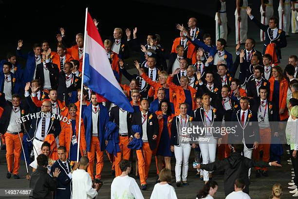 Dorian van Rijsselberghe of the Netherlands Olympic sailing team carries his country's flag during the Opening Ceremony of the London 2012 Olympic...