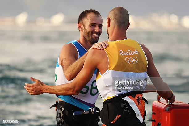 Dorian van Rijsselberghe of the Netherlands reacts after being assured of gold along with Nick Dempsey of Great Britain who is assured of silver in...