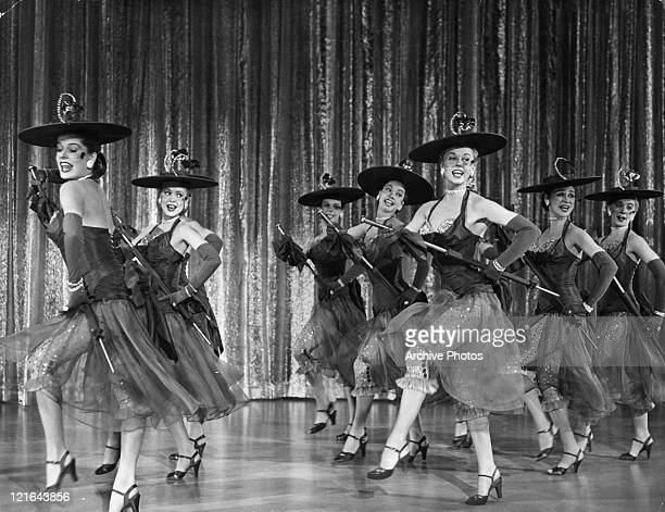 Dorinda Clifton Crystal White Nolie Miller Jean Harrison Doris Day Dean Myles and Beverly Thomas dance in a scene from the film 'April In Paris' 1952