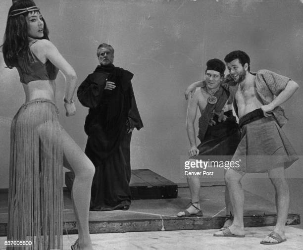 Dorinda Edwards as Orpah tempts Gideon right and a soldier left in the forthcoming Bonfils Theater production of 'Gideon' a drama by Paddy Chayefsky...