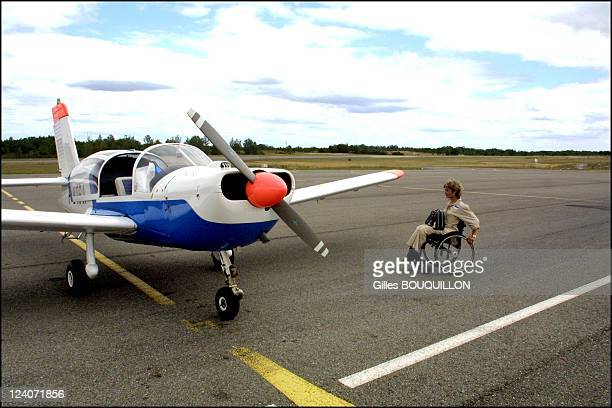 Dorine Bourneton paraplegic after crash and now a pilot for fire In France On July 27 2002