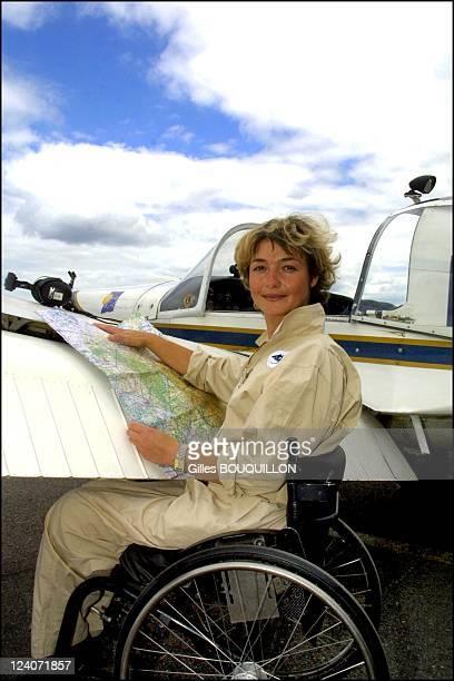 Dorine Bourneton paraplegic after crash and now a pilot for fire In France On July 27 2002