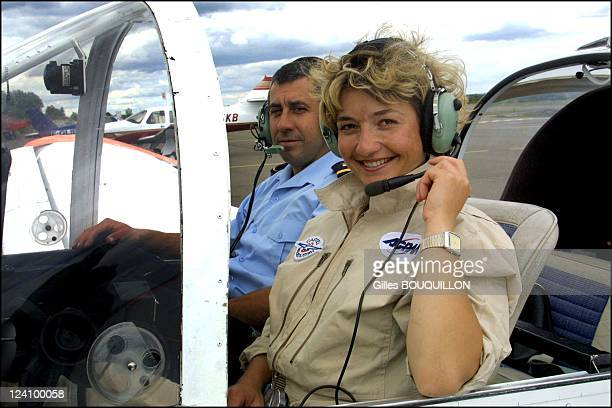 Dorine Bourneton paraplegic after crash and now a pilot for fire In France On July 27 2002 Here on board a specially equipped Rallye aircraft with...
