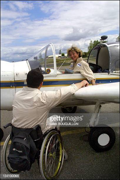Dorine Bourneton paraplegic after crash and now a pilot for fire In France On July 27, 2002 - With an other paraplegic pilot of her association.