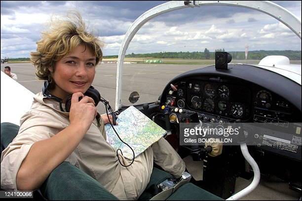 Dorine Bourneton paraplegic after crash and now a pilot for fire In France On July 27 2002 Here on board a specially equipped Rallye aircraft