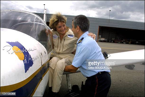 Dorine Bourneton paraplegic after crash and now a pilot for fire In France On July 27, 2002 - Here on board a specially equipped Rallye aircraft with...
