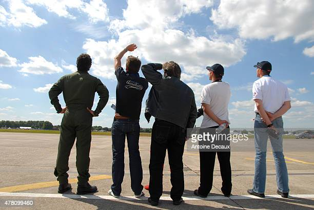 Dorine Bourneton's crew watch as the first worldwide aerobatic show performed by a paraplegic woman takes place at the Paris Air Show 2015 in Le...