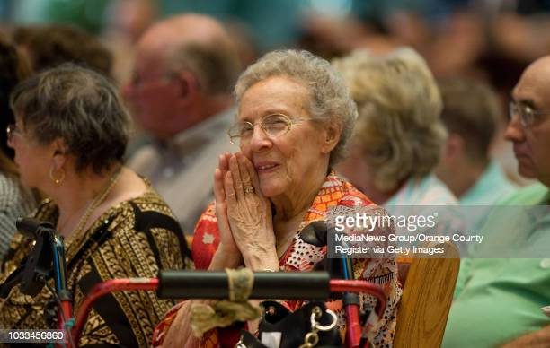 Doris Carlton of Anaheim Hills is moved as she listens to big band music during early Sunday services at Shepherd's Grove church in Garden Grove....