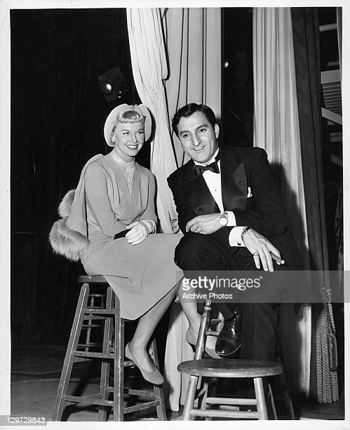 Doris Day and Danny Thomas pose for the still photographer in between scenes of the film 'I'll See You In My Dreams' 1951